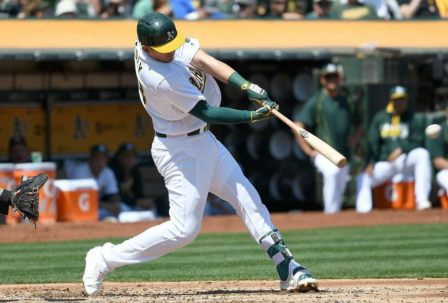 OAKLAND, CA - AUGUST 24:  Ryon Healy #48 of the Oakland Athletics hits an rbi single scoring Khris Davis #2 against the Cleveland Indians in the bottom of the second inning at the Oakland Coliseum on August 24, 2016 in Oakland, California.  (Photo by Thearon W. Henderson/Getty Images) Photo: Thearon W. Henderson, Getty Images