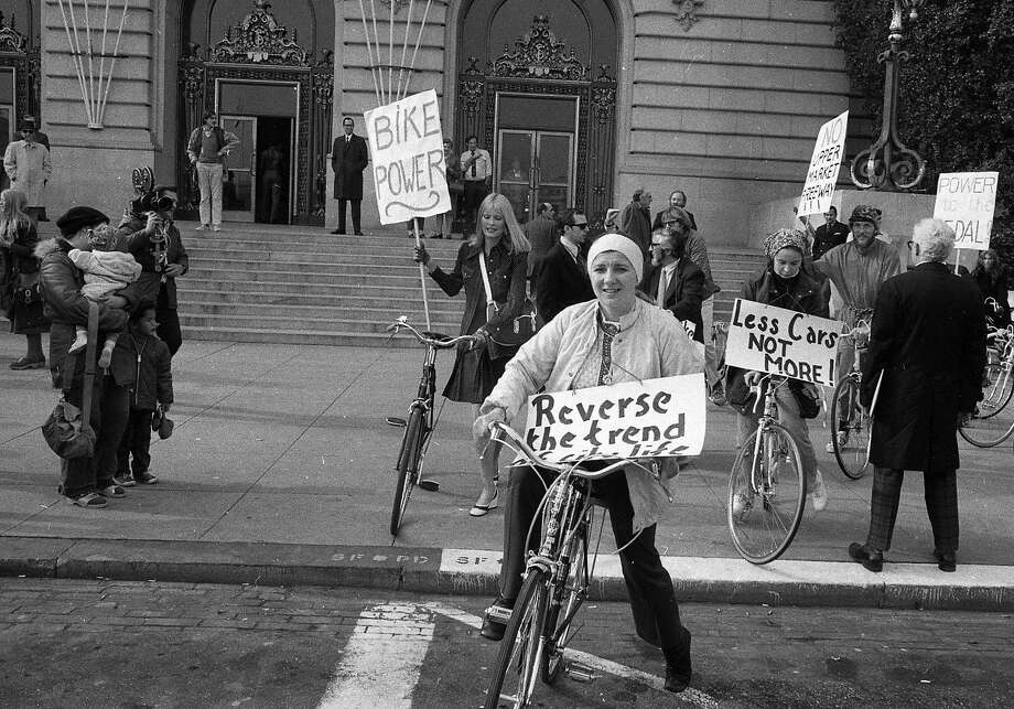A bicyclist from San Francisco holds a sign in front of City Hall during a 1972 protest. Photo: Joe Rosenthal, The Chronicle