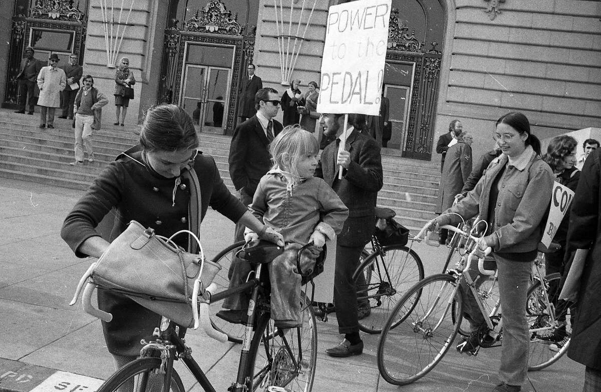 Jan. 12, 1972: A woman and a girl stop their bike during a protest in front of City Hall. The bicyclists were upset about unsafe bicycling conditions on Market Street.