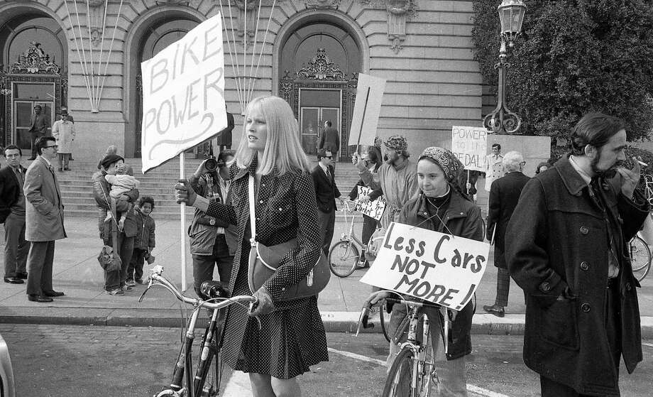 Jan. 12, 1972: San Francisco bicyclists hold up signs during a 1972 protest in front of City Hall. They were seeking a dedicated bike lane on Market Street. Photo: Joe Rosenthal / The Chronicle