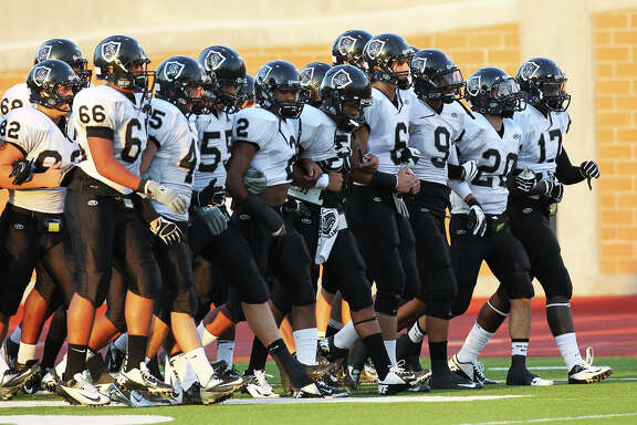 The Steele Knights stroll onto the field for their game against Madison at Heroes Stadium on Aug. 31, 2012.