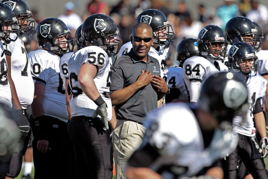 Steele coach Mike Jinks works with his players prior to the game as MacArthur plays Steele at Heroes Stadium in fourth round 5A playoffs on Saturday Dec. 4, 2010. Tom Reel/Staff Photo: Tom Reel /San Antonio Express-News / © 2010 San Antonio Express-News