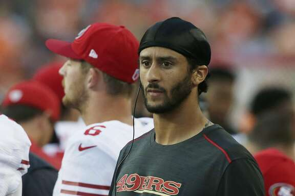 San Francisco 49ers quarterback Colin Kaepernick holds a tablet computer as he stands on the sideline during the first half of a preseason NFL football game against the Denver Broncos, Saturday, Aug. 20, 2016, in Denver. (AP Photo/Joe Mahoney)
