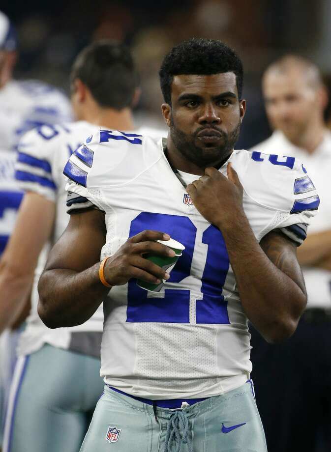 FILE - In this Aug. 19, 2016, file photo, Dallas Cowboys running back Ezekiel Elliott (21) stands on the sideline during the second half of an NFL preseason football game against the Miami Dolphins, in Arlington, Texas. Rookie Ezekiel Elliott is expected to make his preseason debut against Seattle Thursday, Aug. 25, 2016, and get quite the initial test against one of the best defenses in the NFL.(AP Photo/Ron Jenkins, File) Photo: Ron Jenkins/Associated Press