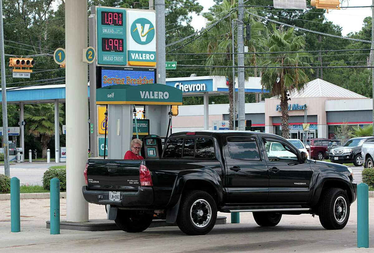 Katie Leonard fills her truck up with gasoline at the Easy Lane Food Mart and Valero gas station in the 5200 block of Louetta Aug. 24, 2016, in Spring. ( James Nielsen / Houston Chronicle )