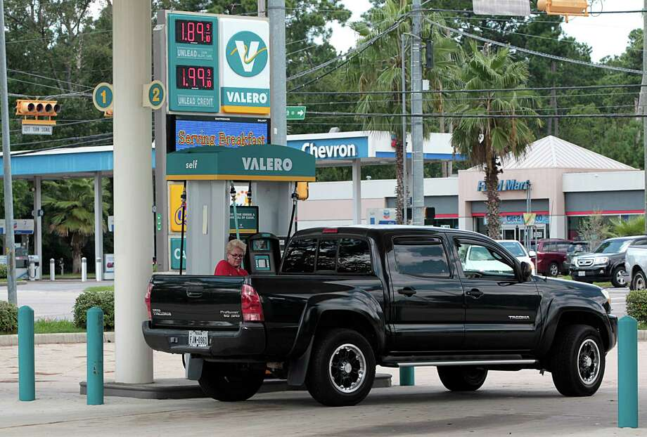 Katie Leonard fills her truck up with gasoline at the Easy Lane Food Mart and Valero gas station in the 5200 block of Louetta Aug. 24, 2016, in Spring. ( James Nielsen / Houston Chronicle ) Photo: James Nielsen, Staff / © 2016  Houston Chronicle