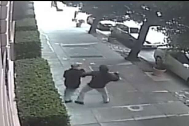 San Francisco Police are hunting for a man who brutally beat a woman police say he randomly targeted on a sidewalk near Lafayette Park in the city's Pacific Heights neighborhood on Saturday, Aug. 20, 2016.