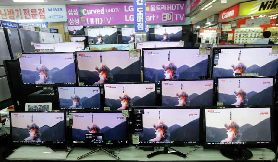 TV screens show file footage of a similar North Korea's ballistic missile that North Korea claimed to have launched from underwater at the Yongsan Electronic store in Seoul, South Korea, Wednesday, Aug. 24, 2016. A North Korean ballistic missile fired from a submarine Wednesday flew about 500 kilometers (310 miles) in the longest flight by that type of weapon, Seoul officials said, a range that can place much of South Korea within its striking distance. (AP Photo/Ahn Young-joon) Photo: Ahn Young-joon, STF / Copyright 2016 The Associated Press. All rights reserved. This material may not be published, broadcast, rewritten or redistribu