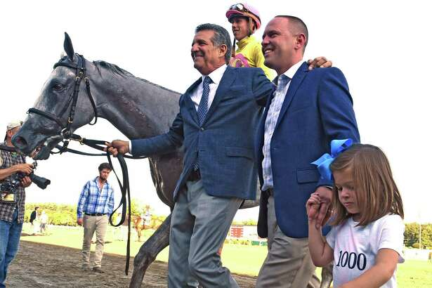 Trainer Chad Brown, second from right recorded his 1000th win as he and principal owner Michael Dubb lead Mr Maybe with jockey Irad Ortiz Jr. to the winner's circle after winning the 13th running of The John's Call Wednesday August 24, 2016 at the Saratoga Race Course in Saratoga Springs, N.Y.    (Skip Dickstein/Times Union)