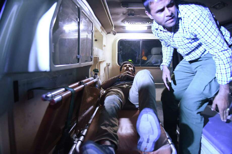 An Afghan man lies on a stretcher inside an ambulance near the site of an explosion that targeted American University of Afghanistan in Kabul on Wednesday. It was the second attack this month at the elite school.  Photo: WAKIL KOHSAR, Stringer / AFP or licensors