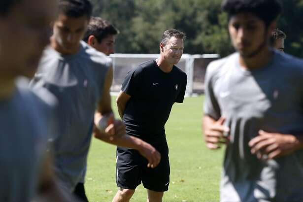 Cardinal soccer head coach Jeremy Gunn watches his team warm up for a practice in Stanford, Calif. on Aug. 24, 2016. The Cardinal soccer team hosts Penn State on Friday as the season opener after capturing the National Championship last year.