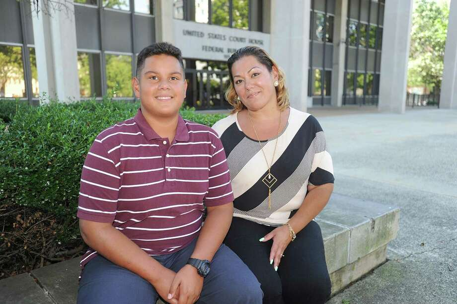 Jose Martinez (L) and his mother Jessica Martinez, lead plaintiff in Martinez v. Malloy, pose for a photo outside the U.S. District Court for the District of Connecticut on August 24, 2016 in Bridgeport, Connecticut. Martinez v. Malloy is a federal education equality lawsuit against the State of Connecticut, filed by a group of students and parents with the support of Students Matter. Photo: Brad Barket / Getty Images For Rally / 2016 Getty Images
