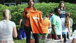 Ashley Alcantara sells shirts for a planned demonstration as students stage a protest against new campus carry rules for firearms on August 24, 2016