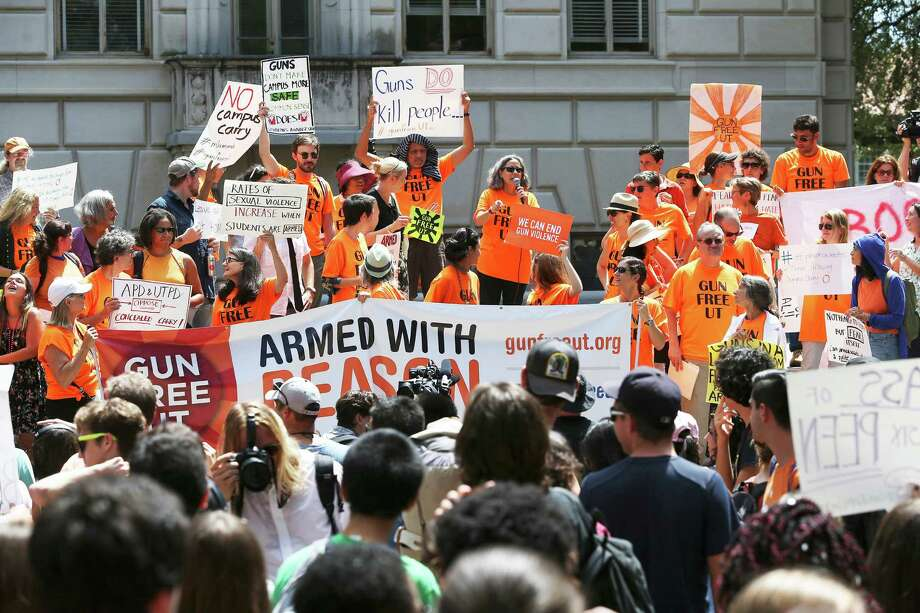 Speakers address the crowd as students stage a protest against new campus carry rules for firearms on August 24, 2016 Photo: TOM REEL, STAFF / SAN ANTONIO EXPRESS-NEWS / 2016 SAN ANTONIO EXPRESS-NEWS