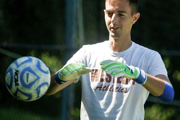 Western Connecticut State University men's soccer goaltender Luca DiCarlo works on catching the ball during a practice. Tuesday, Aug. 23, 2016