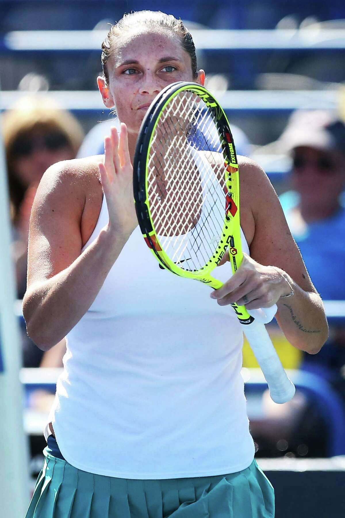 Roberta Vinci of Italy waves to the crowd after her victory over Ana Konjuh of Croatia at the Connecticut Open on Wednesday.