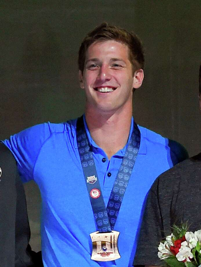 "FILE - In this July 3, 2016, file photo, U.S. swimmer Jimmy Feigen smiles during the men's 400-meter relay team medal ceremony at the U.S. Olympic swimming trials, in Omaha, Neb. Feigen apologized for the ""serious distraction"" he and three teammates caused at a gas station during the Rio Olympics, saying he omitted facts in his statement to police. Feigen says in a statement posted Tuesday, Aug. 23, 2016, on the website of his lawyer in Austin, Texas, that ""I omitted the facts that we urinated behind the building and that Ryan Lochte pulled a poster off the wall."" (AP Photo/Mark J. Terrill, File) ORG XMIT: NY163 Photo: Mark J. Terrill / Copyright 2016 The Associated Press. All rights reserved. This m"