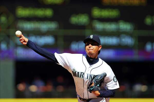 Seattle's Hisashi Iwakuma pitches in the fourth inning of the Mariners's game against the New York Yankees, Wednesday, Aug. 24, 2016 at Safeco Field. The Yankees won 5-0.