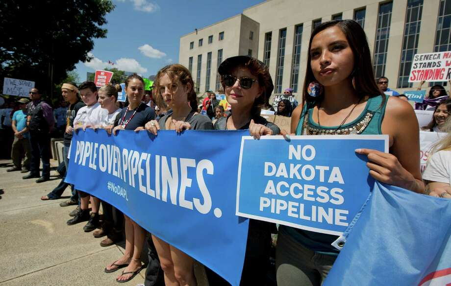 Actresses Shailene Woodley, fourth from right, and Susan Sarandon, second from right, and Standing Rock Sioux Tribe member Bobbi Jean Three Lakes, right, protest the Dakota Access Pipeline at a rally Wednesday.  Photo: Manuel Balce Ceneta, STF / Associated Press WashDC