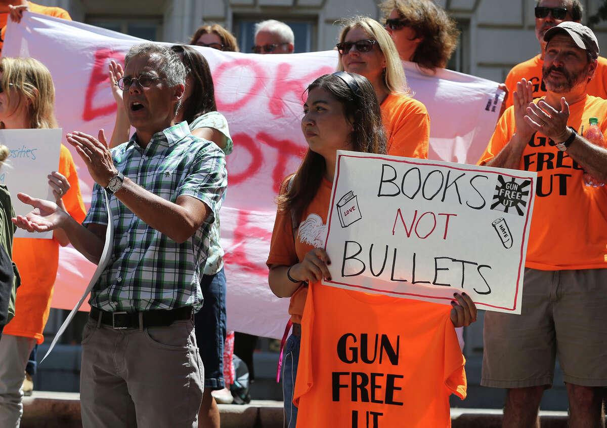 A group calling itself Gun Free UT protests the campus carry law on the steps of the main building (tower) on the University campus Wednesday August 4, 2016.