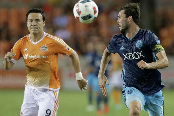 Houston Dynamo forward Erick Torres (9) and Seattle Sounders forward Brad Evans (3) go after the ball during an MLS game action on Wednesday, Aug. 24, 2016, in Houston.