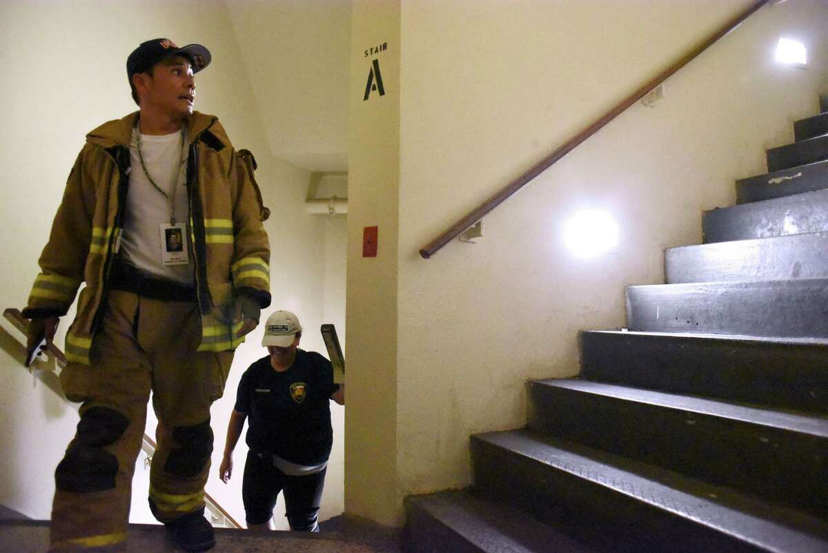 Firefighter Abel Campos, a member of the San Antonio 110 9/11 Memorial Climb committee, climbs the Tower of the Americas stairs on Wednesday, Aug. 24, 2016, in honor of fallen New York firefighters who lost their lives on Sept. 11, 2001. The committee members climbed so that on September 11, when the actual event takes place, they can act as organizers and guides for the hundreds of people expected to climb the tower stairs on that day.