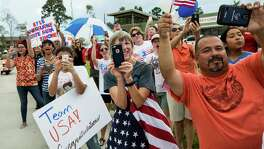 Fans wave as Olympic Gold Medalist Simone Biles rides past them during a welcome home parade along Rayford Road on Wednesday, Aug. 24, 2016, in Spring. ( Brett Coomer / Houston Chronicle )