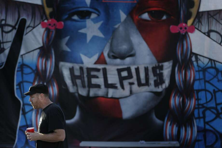 """Event organizer, John Pomeroy walks around and checks if guests have everything they need during a watch party at the Soundwave Studios in Oakland, Calif., on Wednesday, August 24, 2016, where supporters listened to Bernie Sanders announcing in detail what the next step of his """"political revolution."""" Photo: Carlos Avila Gonzalez, The Chronicle"""
