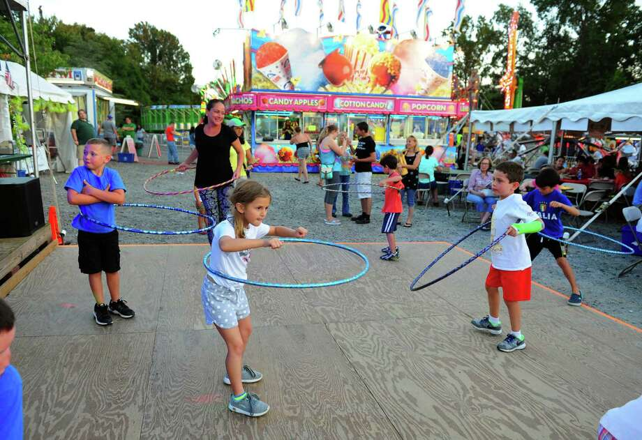Sophia Fabrizio, 8, of Monroe, takes part in a hoola hoop contest during St. Jude Italian Festival at St. Jude's Parish in Monroe, Conn., on Wednesday Aug. 24, 2016. The festival continues from Aug. 26, from 6-10:30 p.m. and Aug. 27, from 5-10:30 p.m. There is free admission and free parking. $25 rides bracelet every night. There will be games, a 50/50 raffle, and food. For more information call: 203-261-6404, or visit www.stjuderc.com. Photo: Christian Abraham / Hearst Connecticut Media / Connecticut Post