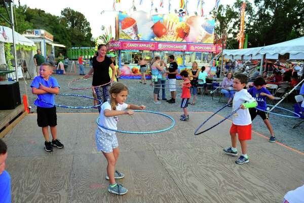 Sophia Fabrizio, 8, of Monroe, takes part in a hoola hoop contest during St. Jude Italian Festival at St. Jude's Parish in Monroe, Conn., on Wednesday Aug. 24, 2016. The festival continues from Aug. 26, from 6-10:30 p.m. and Aug. 27, from 5-10:30 p.m. There is free admission and free parking. $25 rides bracelet every night. There will be games, a 50/50 raffle, and food. For more information call: 203-261-6404, or visit www.stjuderc.com.