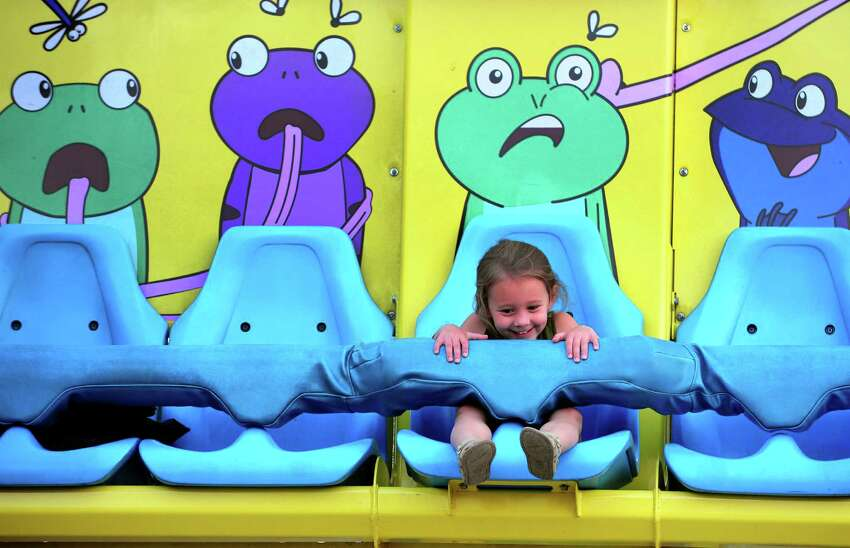 Evalie Mitchell, 3, of Monroe, enjoys one of the kiddie rides at St. Jude Italian Festival at St. Jude's Church in Monroe, Conn., on Wednesday Aug. 24, 2016. The festival continues from Aug. 26, from 6-10:30 p.m. and Aug. 27, from 5-10:30 p.m. There is free admission and free parking. $25 rides bracelet every night. There will be games, a 50/50 raffle, and food. For more information call: 203-261-6404, or visit www.stjuderc.com.