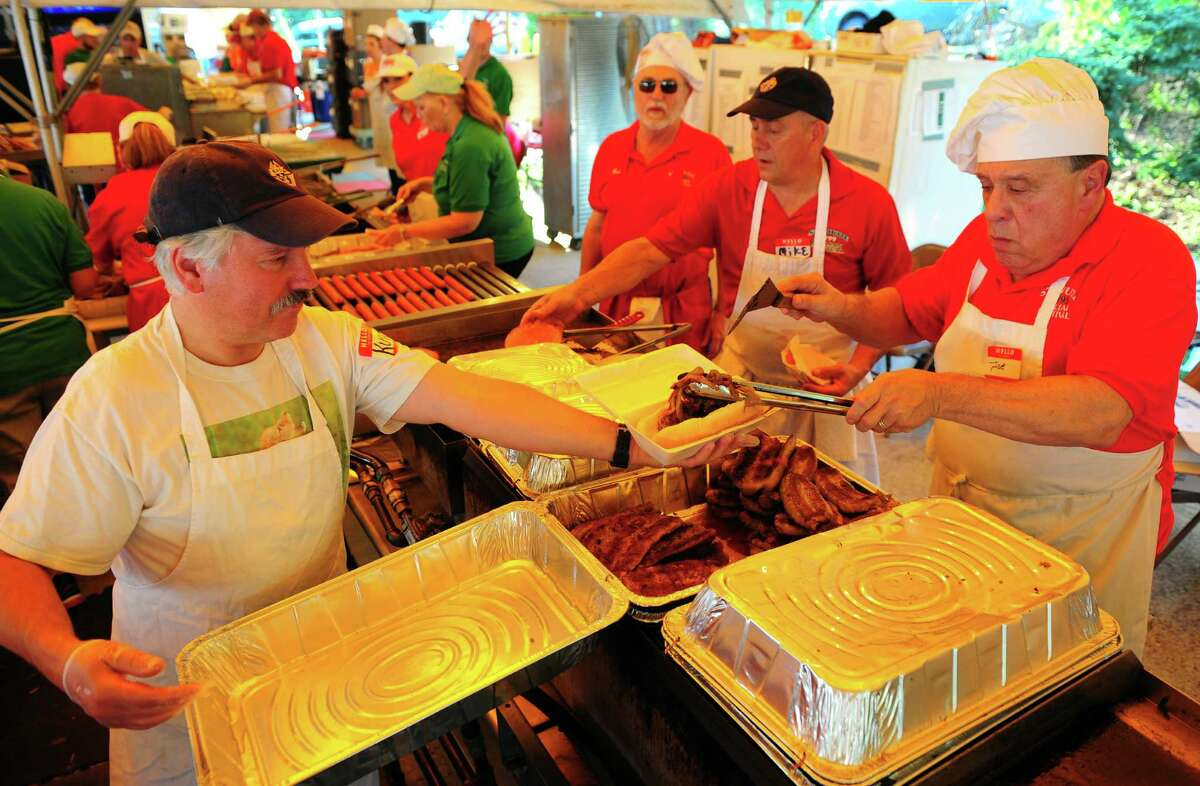 Volunteers Kurt Solek, left, and Joe Palmisano get orders for customers at St. Jude Italian Festival at St. Jude's Church in Monroe, Conn., on Wednesday Aug. 24, 2016. The festival continues from Aug. 26, from 6-10:30 p.m. and Aug. 27, from 5-10:30 p.m. There is free admission and free parking. $25 rides bracelet every night. There will be games, a 50/50 raffle, and food. For more information call: 203-261-6404, or visit www.stjuderc.com.