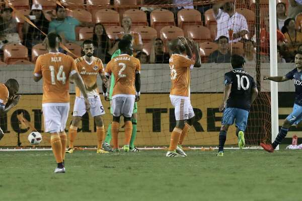 Houston Dynamo react after a last-second goal by Nicolas Lordeiro (10) ties the game 1-1 in the final minute of game action on Wednesday, Aug. 24, 2016, in Houston.