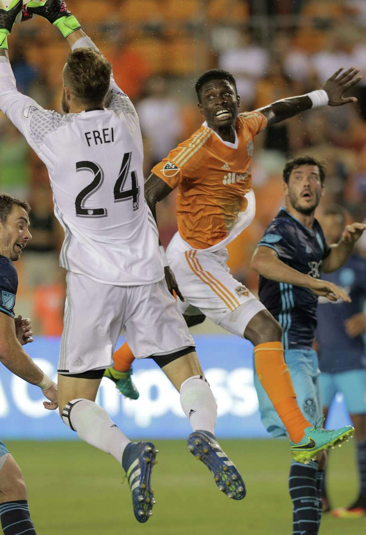 Seattle Sounders goalkeeper Stefan Frei (24) makes a save from Houston Dynamo midfielder Ricardo Clark (13) during MLS game action on Wednesday, Aug. 24, 2016, in Houston. The teams tied 1-1.
