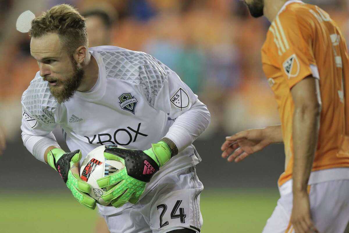 Seattle Sounders goalkeeper Stefan Frei (24) makes a save in the second half of MLS game action against Houston Dynamo on Wednesday, Aug. 24, 2016, in Houston.