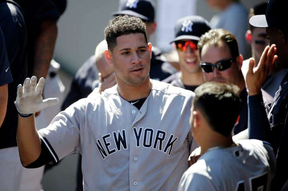 New York Yankees' Gary Sanchez is congratulated on his home run against the Seattle Mariners in the first inning of a baseball game Wednesday, Aug. 24, 2016, in Seattle. (AP Photo/Elaine Thompson) ORG XMIT: WAET103 Photo: Elaine Thompson / Copyright 2016 The Associated Press. All rights reserved. This m