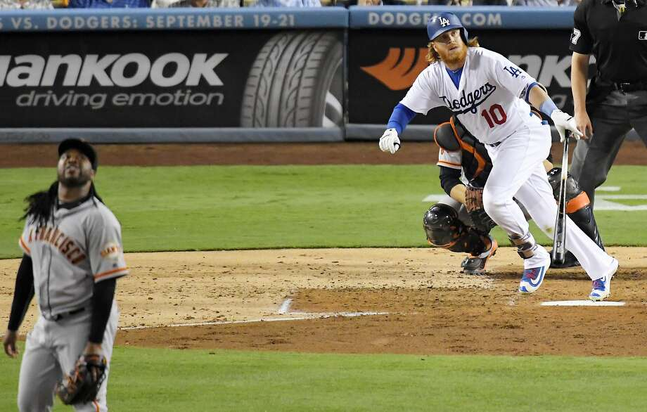 Los Angeles Dodgers' Justin Turner and San Francisco Giants starting pitcher Johnny Cueto watch Turner's home run during the fourth inning of a baseball game, Wednesday, Aug. 24, 2016, in Los Angeles. (AP Photo/Mark J. Terrill) Photo: Mark J. Terrill, Associated Press
