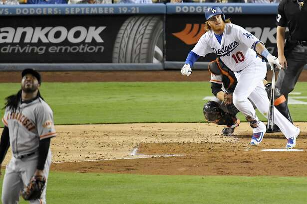 Los Angeles Dodgers' Justin Turner and San Francisco Giants starting pitcher Johnny Cueto watch Turner's home run during the fourth inning of a baseball game, Wednesday, Aug. 24, 2016, in Los Angeles. (AP Photo/Mark J. Terrill)