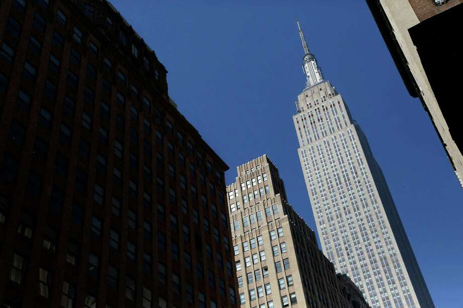 Qatar's investment authority, estimated to be worth $335 billion, owns a stake in the Empire State Building. Photo: Mark Lennihan, STF / Copyright 2016 The Associated Press. All rights reserved. This material may not be published, broadcast, rewritten or redistribu