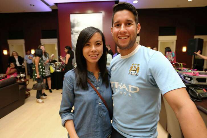 Madeleine Nguyen-Cao, left, and Eduardo Henriquez pose for a photo at Diamonds & Desserts bridal trend event benefitting Girls Inc. Wednesday, Aug. 24, 2016, in Houston. The event was hosted at Robbins Brothers.