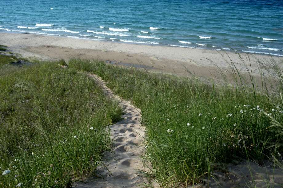 FILE —Waves from Lake Michigan roll into beaches along the Sleeping Bear Dunes National Lakeshore. Photo: Brittney Lohmiller/Midland Daily News