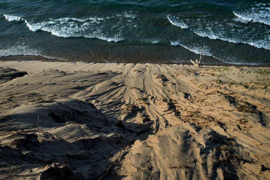 Waves from Lake Michigan roll into beaches along the Sleeping Bear Dunes National Lakeshore on July 29.  In 1961, Sen. Philip Hart of Michigan introduced legislation to add Michigan's Sleeping Bear Dunes and surrounding acres to America's National Park system. The park has 71,213 acres and 65 miles of lakeshore. On Oct. 21, 1970, the Sleeping Bear Dunes National Lakeshore was added to the National Park Service. On August 25 of this year, the National Park Service turns 100 years old. Photo: Brittney Lohmiller/Midland Daily News