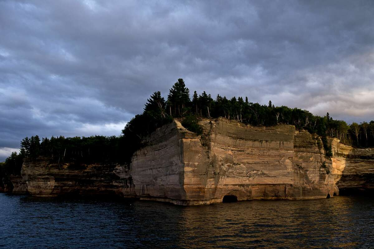 FILE - Battleship Row is illuminated by sunlight at Pictured Rocks National Lakeshore on July 13, 2016.