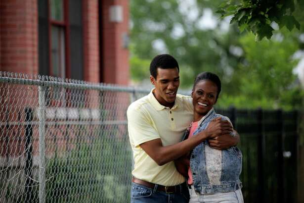 """This image released by Roadside Attractions shows Tika Sumpter, right, and Parker Sawyers in a scene from """"Southside With You."""" (Pat Scola/Miramax and Roadside Attractions via AP)"""