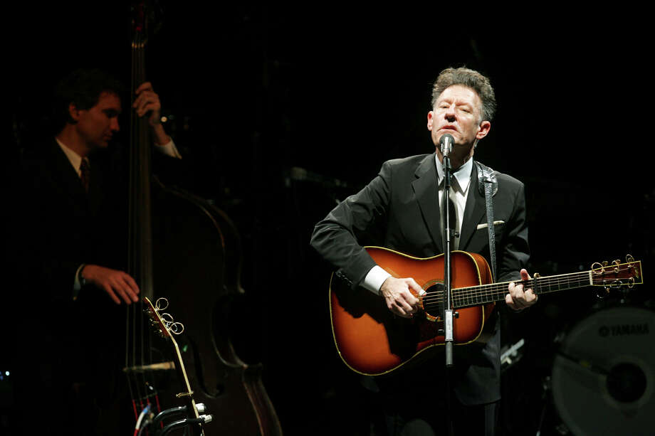 Lyle Lovett brought His Large Band to the Majestic Theatre in 2009. He returns with his band tonight for a performance. Photo: Express-News File Photo / San Antonio Express-News
