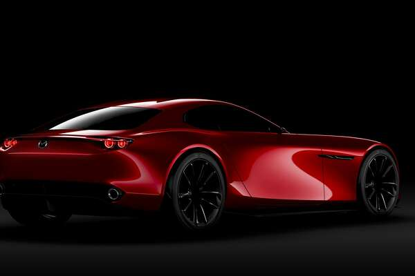 "FILE - An undated handout photo of the Mazda RX-VISION, a rotary-powered sports car concept. The vehicle won the ""Most Beautiful Concept Car of the Year"" award at the 31st Festival Automobile International in Jan. 27, 2016."