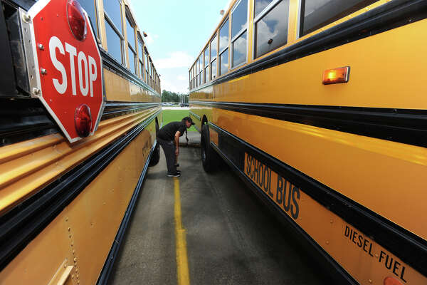 Kristy Raley a Vidor school bus driver placed first in an international bus driving rodeo earlier this summer. The contest consisted of a written test, exercising knowledge of safety procedure and illustrating control of the large vehicle.  Raley checks the outside of the bus before her Tuesday shift. Photo taken Tuesday, August 23, 2016 Guiseppe Barranco/The Enterprise