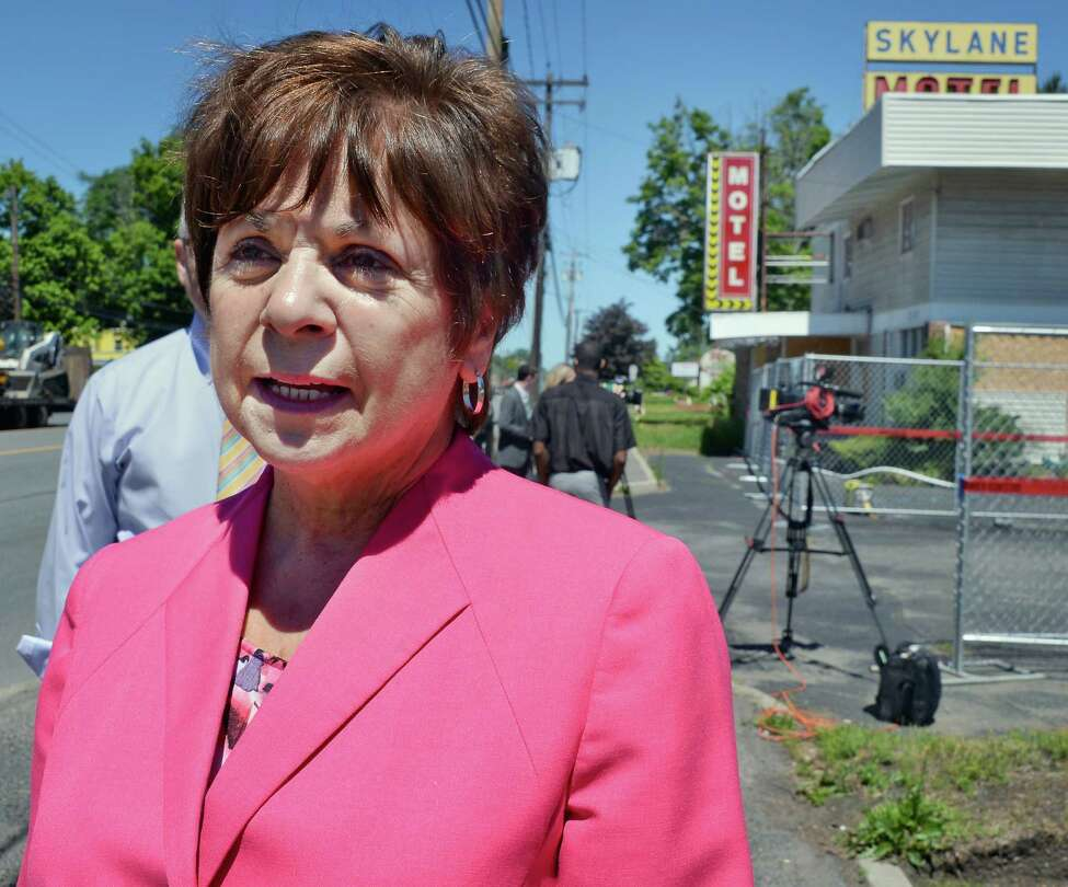 Town Supervisor Paula Mahan outside the former Skylane Motel on Central Avenue as demolition finally begins Tuesday June 14, 2016 in Colonie, NY. (John Carl D'Annibale / Times Union)