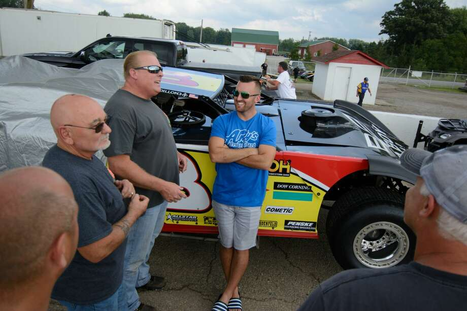 Austin Dillon working with his pit crew and greeting fans prior to the race in the Late Model Series Championship at Tri-City Motor Speedway Wednesday. Photo: Steven Simpkins For The Daily News