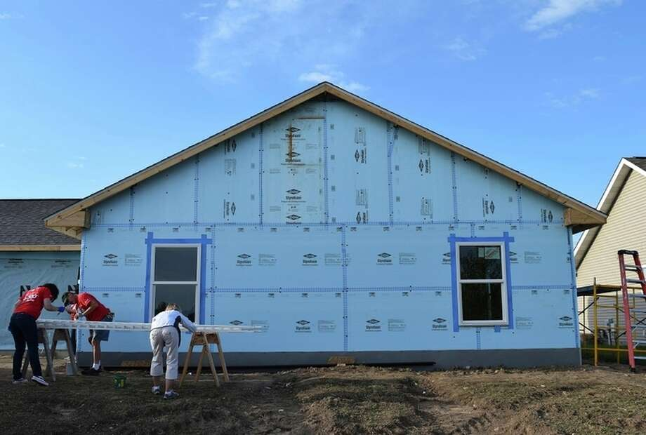 The blue sky matches the blue Dow Chemical Styrofoam used to insulate a Saginaw-Shiawassee Habitat for Humanity build in Freeland. The house is the 50,000 to be constructed with help from The Dow Chemical Co. in 34 years. Photo byJessica Haynes | jhaynes@mdn.net